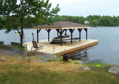 Steel pile dock and boat port with wet slip boat lift